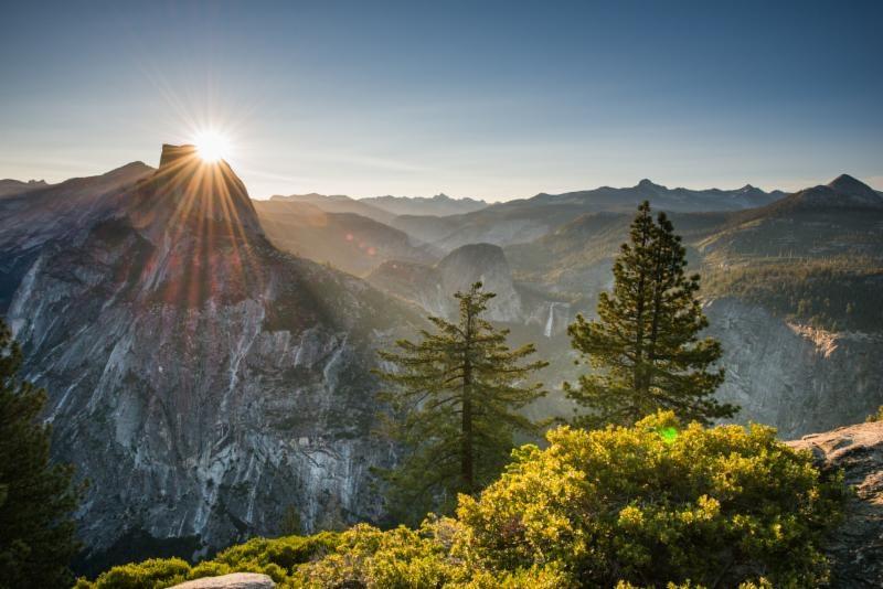 Image of Sun Behind Half Dome Yosemite Bass Lake Realty